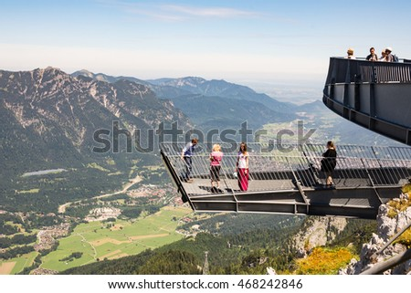 GARMISCH, GERMANY - JULY 10: Tourists at the Alpspix observation deck on the Osterfeldkopf mountain in Garmisch, Germany on July 10, 2016. The deck is 1000 m above the valley.