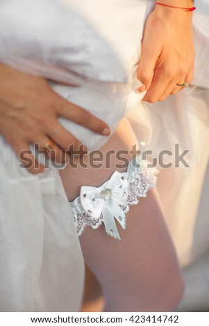 garter, wedding, bride, dress, white, leg, sexy, beautiful, beauty, ribbon, romance, day, bridal, hand, love, body, tradition, woman, lace, stockings, belt, fashion, romantic, skin, innocence