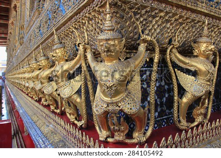 Garuda, a large bird-like creature or humanoid bird that appears in both Hinduism and Buddhism is decorated on the wall of Emerald Buddha Temple in Bangkok, Thailand.  - stock photo