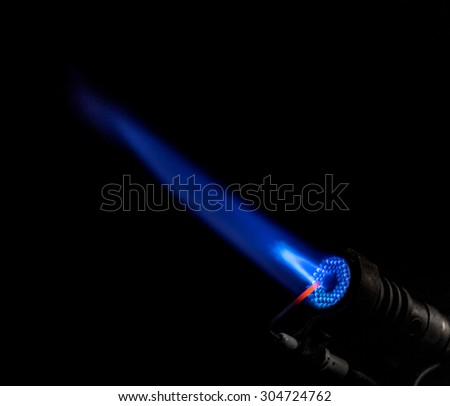 Gas burner flame. Blue isolated on black