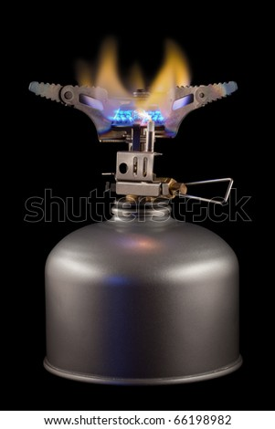 gas burner with blue flame on black background