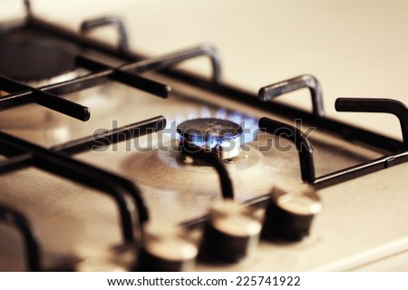 Gas burner with flame on gas cooker - stock photo