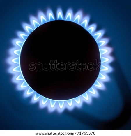 Gas burners in the kitchen oven - stock photo