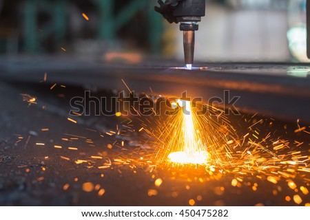 Gas cutting and flame sparking, Industrial background.