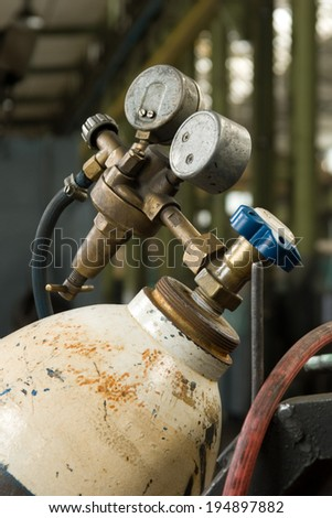 Gas Cylinder and pressure gauge in factory - stock photo