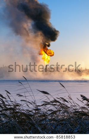 Gas flaring. Evaporation of snow. - stock photo