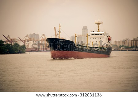 gas lpg container tanker ship running in river use for petrochemical gas energy in water transportation industry - stock photo