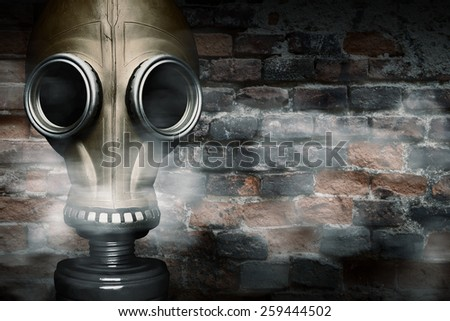 Gas mask shrouded in smoke - stock photo
