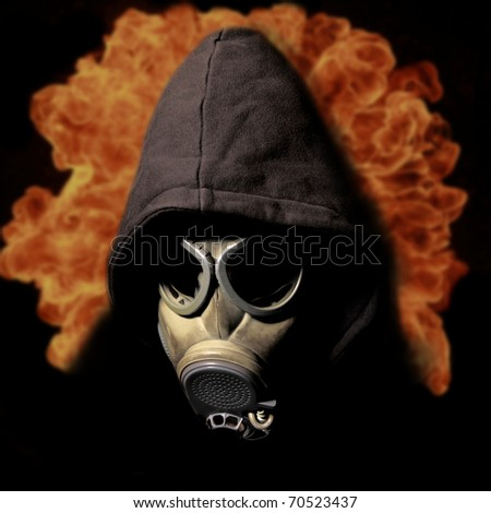 Gas mask with fire explosion - stock photo