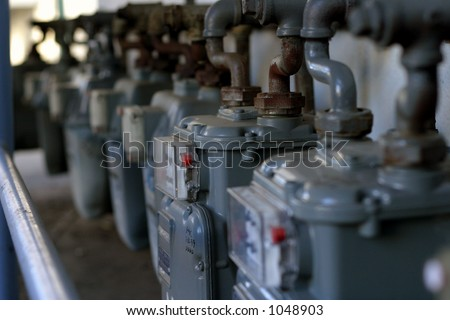 Gas meters in a row - stock photo