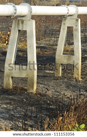 gas pipe line that laid through burn field - stock photo