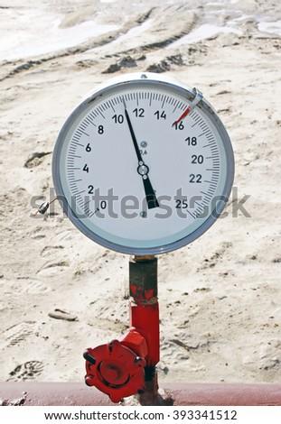 Gas pipe. Manometr - stock photo