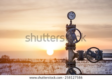 Gas pipe with pressure gauge - stock photo
