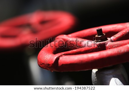 Gas pipe with two red valve - stock photo