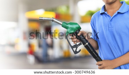 Gas pump for refueling car on gas station - stock photo