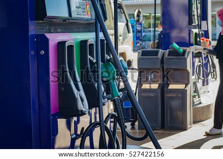 Gas pump nozzles in service station,Colorful pump nozzles.