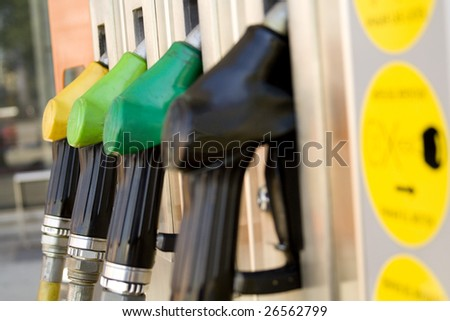gas pump nozzles on a service station