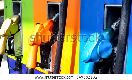 gas pump station nozzles colorful - stock photo