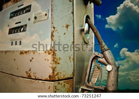 Gas pump with blue sky background - stock photo