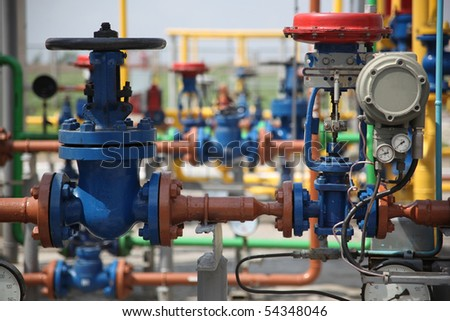 Gas refinery pipes - stock photo
