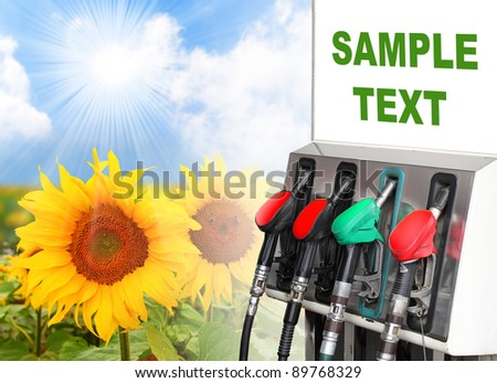 Gas station and sunflowers field. Ecology concept. Space for your text. - stock photo