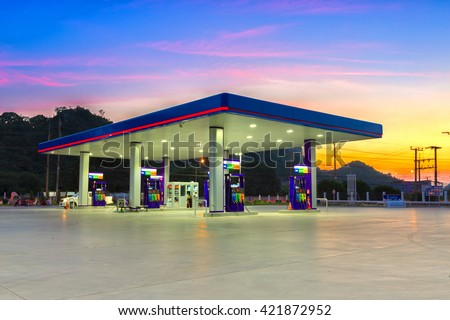 Gas station at sunset. - stock photo