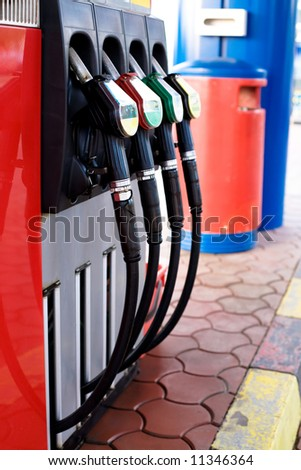 Gas station nozzles. Fuel and fossil gas consumption concept - stock photo