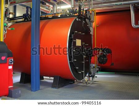 Gas steel boiler established in modern independent boiler-house - stock photo