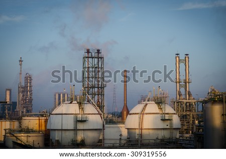 Gas storage tanks and petrochemical  plant at morning time - stock photo
