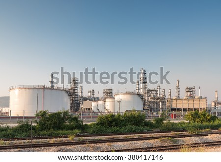 Gas tank oil petrochemical plant at sunset