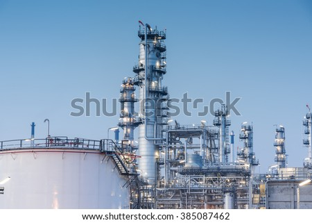 Gas tank oil petrochemical plant at sunset - stock photo