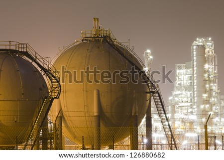 Gas tanks and a large oil-refinery plant - stock photo