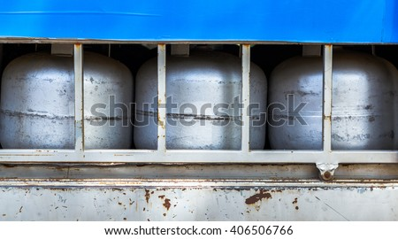 gas tanks inside truck container - stock photo
