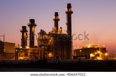 Gas turbine electrical power plant at dusk with light - stock photo