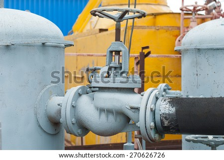 Gas valve on the pipe between the receivers. - stock photo