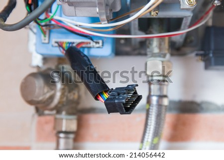 Gas water heater with the casing removed for survey. - stock photo