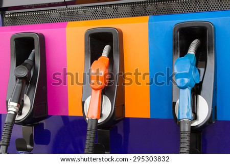 Gasoline Pump nozzles at the gas station - stock photo