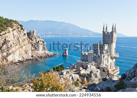 GASPRA, RUSSIA - SEPTEMBER 29, 2014: Black Sea coastline with Swallow's Nest castle in Crimea. The castle was built in 1911-1912, on top of the 40-metre high Aurora Cliff - stock photo