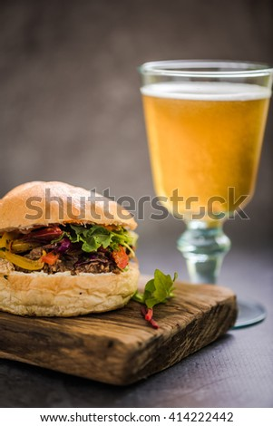 gastro pub local food, bbq burger and Ale beer or cider - stock photo