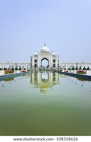 Gate of the Mosque reflected in a pond at the Hui Cultural Center in Yinchuan, Ningxia Province, China - stock photo