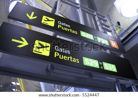 gate sign panel in airport, madrid, spain - stock photo