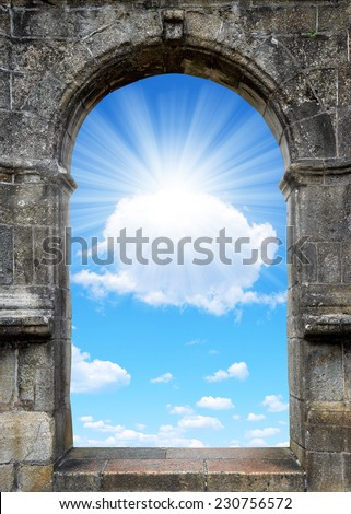 Gate to heaven with sunny sky - stock photo
