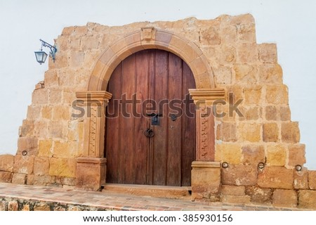 Gate to old colonial house in Barichara village, Colombia - stock photo