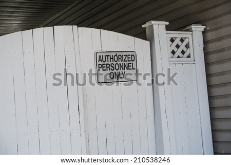 gate with authorized personnel only sign - stock photo