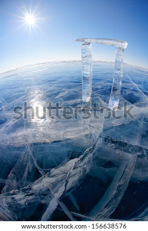 Gates made from ice on lake Baikal in Sineria under winter Sun - stock photo