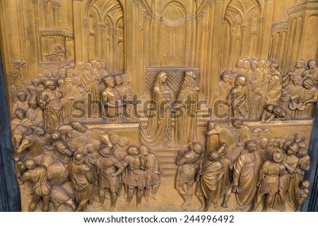 Gates of Paradise with Bible stories on door panels of Duomo Baptistry, Florence, Italy - stock photo