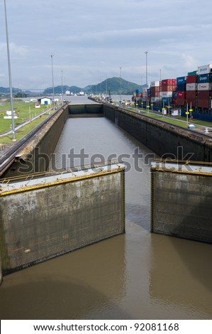 Gates of the Miraflores Locks in Panama Canal opening to allow ships in - stock photo