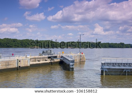 Gates opening at lock and dam 7 on Upper Mississippi River in La Crescent Minnesota - stock photo