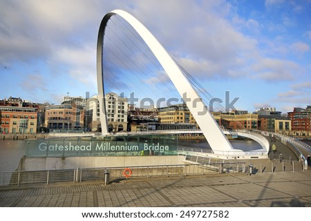 GATESHEAD, ENGLAND - FEBRUARY 1, 2015: Gateshead Millennium Bridge spans the River Tyne in north east England. The bridge is referred to as 'Winking Eye Bridge' due to its shape and its tilting method - stock photo