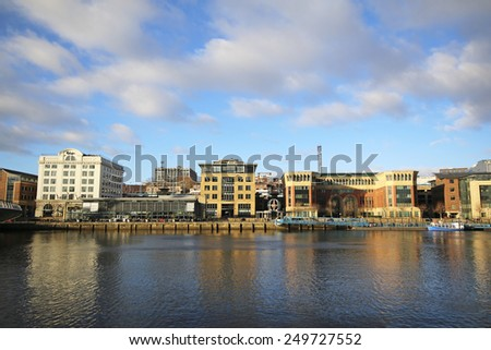GATESHEAD, ENGLAND - FEBRUARY 1, 2015: Offices and house lining the north side of the River Tyne opposite the Baltic Art Gallery and Millennium Bridge - stock photo